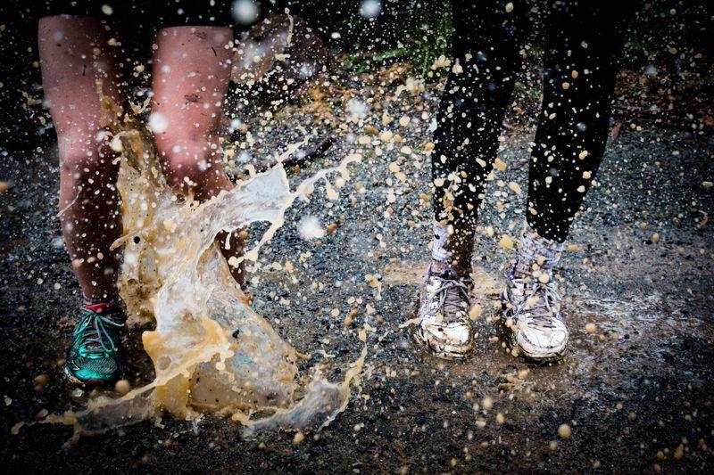 people run in mud