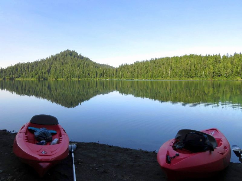 Kayakes on shore of lake
