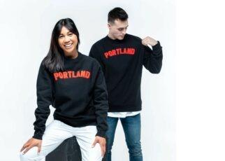 Man and woman wearing Portland shirts