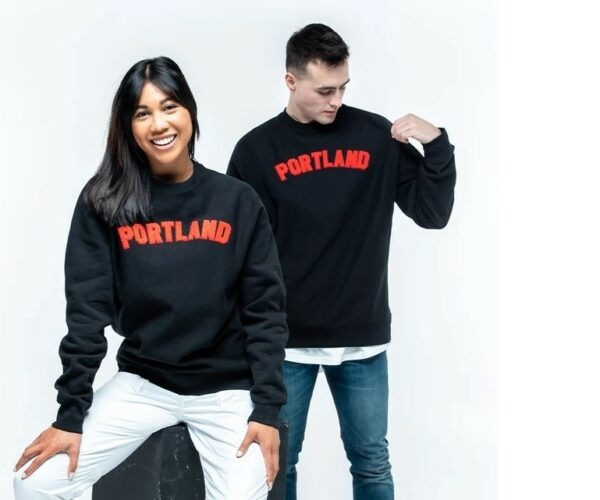 Man and woman wearing Portland shirts