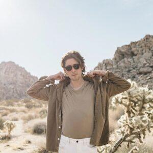 Man wearing thick brown shirt