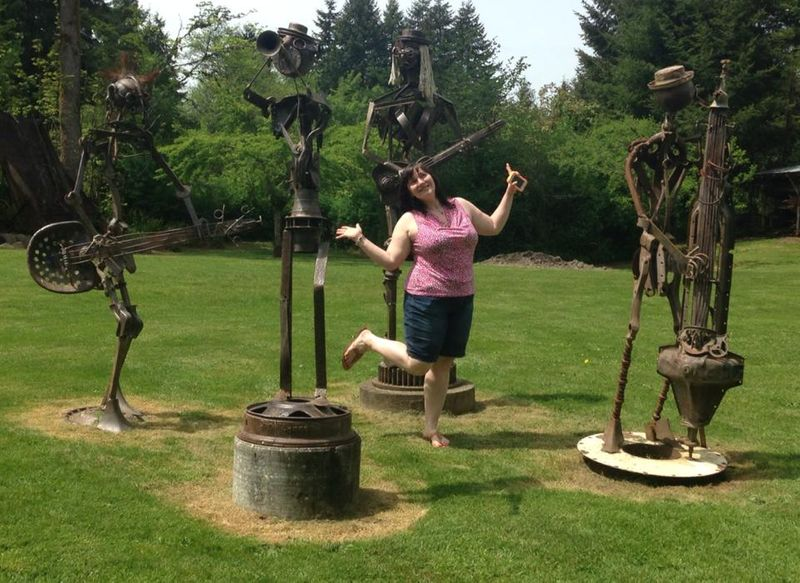 Woman prancing in metal garden